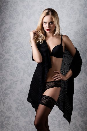 sensual blonde fit female long hair and stylish make-up posing in glamour shoot with black lingerie and lace stockings Stock Photo - Budget Royalty-Free & Subscription, Code: 400-07997166