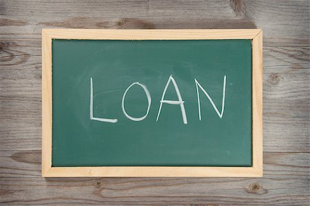 education loan - Handwriting loan letter on chalkboard, wooden background. Stock Photo - Budget Royalty-Free & Subscription, Code: 400-07990381