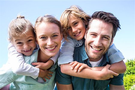 Happy parents with their children in the countryside Stock Photo - Budget Royalty-Free & Subscription, Code: 400-07991225