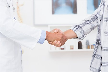 Patient shaking hands with doctor in medical office Stock Photo - Budget Royalty-Free & Subscription, Code: 400-08018481