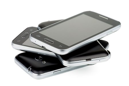 Pile of Four Black Smartphones with Silver Details and Buttons isolated on white background Stock Photo - Budget Royalty-Free & Subscription, Code: 400-08011808