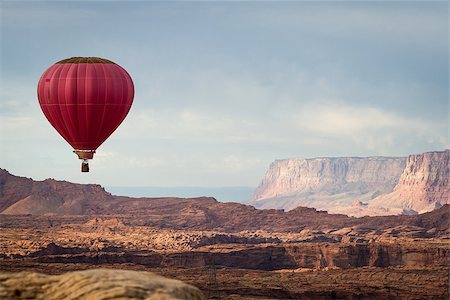 hot air balloon floating over the red navajo sandstone in Arizona with a beautiful landscape Stock Photo - Budget Royalty-Free & Subscription, Code: 400-08032526