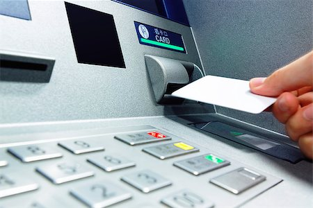 male hand businessman inserts credit card into the ATM and withdraws money Stock Photo - Budget Royalty-Free & Subscription, Code: 400-08045873