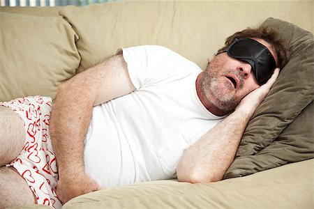 drunk passed out - Lazy man at home in his underwear, sleeping on the couch and snoring. Stock Photo - Budget Royalty-Free & Subscription, Code: 400-08040639