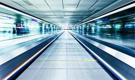 symmetric moving blue escalator inside contemporary airport, hong kong Stock Photo - Budget Royalty-Free & Subscription, Code: 400-08050768