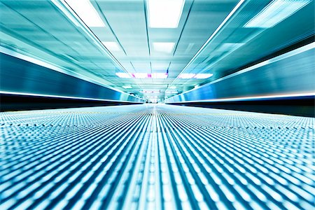 symmetric moving blue escalator inside contemporary airport, hong kong Stock Photo - Budget Royalty-Free & Subscription, Code: 400-08050770