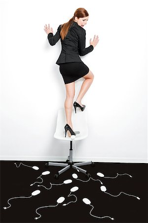 running away scared - Business concept with a beautiful woman in the office being attacked by mice Stock Photo - Budget Royalty-Free & Subscription, Code: 400-08074096