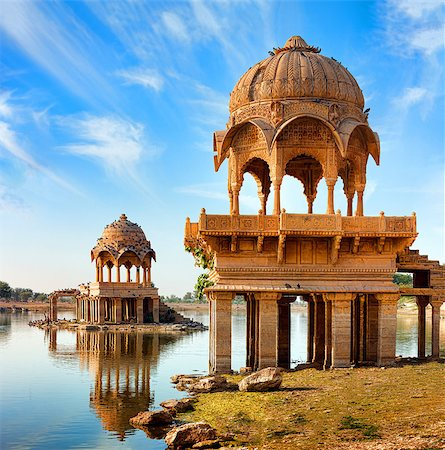 Gadi Sagar (Gadisar) Lake is one of the most important tourist attractions in Jaisalmer, Rajasthan, North India.    Artistically carved temples and shrines around The Lake Gadisar Jaisalmer. Stock Photo - Budget Royalty-Free & Subscription, Code: 400-08075483