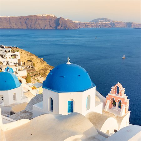 World famous traditional whitewashed chuches and houses of Oia village on Santorini island, Greece. Sunset light. Stock Photo - Budget Royalty-Free & Subscription, Code: 400-08077817