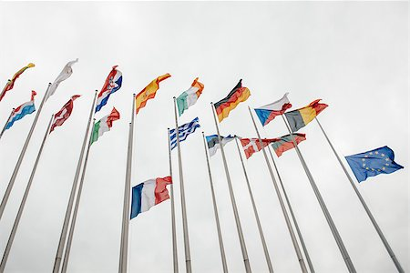 flag at half mast - The French and European Union Flag flies at half-mast in front of the European Parliament in Strasbourg on January 8, 2015 following an attack the day before against French satirical weekly newspaper Charlie Hebdo offices in Paris which left 12 people dead Stock Photo - Budget Royalty-Free & Subscription, Code: 400-08070207