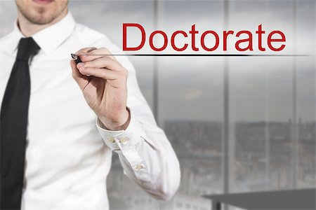 education loan - businessman in office writing doctorate in the air Stock Photo - Budget Royalty-Free & Subscription, Code: 400-08072119