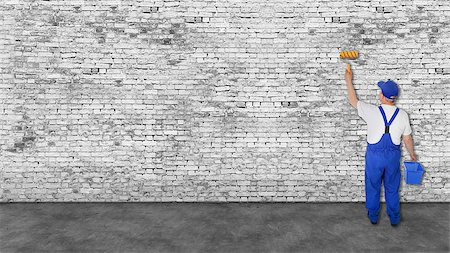 house painter covers very long white brick wall Stock Photo - Budget Royalty-Free & Subscription, Code: 400-08073964