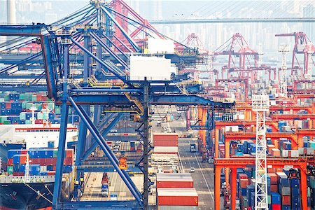 Containers at Hong Kong commercial port at day Stock Photo - Budget Royalty-Free & Subscription, Code: 400-08114382