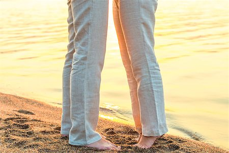 bare feet kissing couple at the sea Stock Photo - Budget Royalty-Free & Subscription, Code: 400-08111294