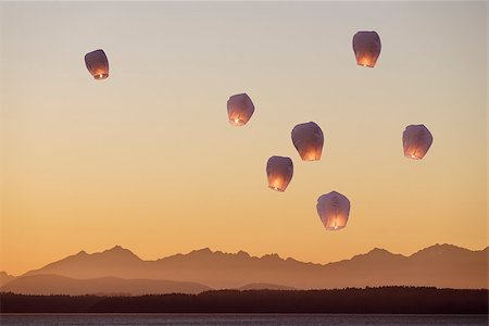 A group of flying lanterns being released into the nightsky Stock Photo - Budget Royalty-Free & Subscription, Code: 400-08111824