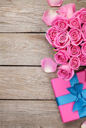 Valentines day background with gift box full of pink roses over wooden table. Top view with copy space Stock Photo - Budget Royalty-Free & Subscription, Code: 400-08112101