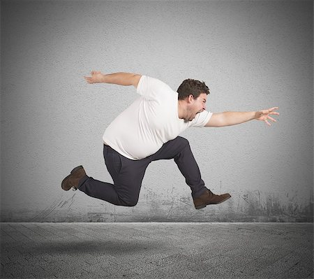 fat man exercising - Fat and pissed man runs for diet Stock Photo - Budget Royalty-Free & Subscription, Code: 400-08113486