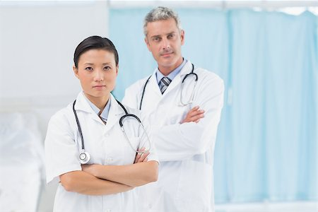 Confident male and female doctors at medical office Stock Photo - Budget Royalty-Free & Subscription, Code: 400-08136208