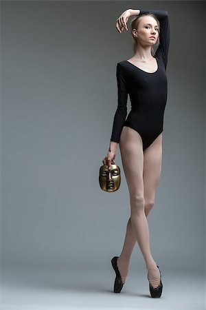 Portrait of the young graceful ballerina with a bronze metal mask in hand Stock Photo - Budget Royalty-Free & Subscription, Code: 400-08154596