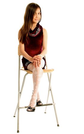 Attractive Teen Girl with Long Brown Hair in Purple Dress Sitting on Chair and Posing isolated on white background Stock Photo - Budget Royalty-Free & Subscription, Code: 400-08155951