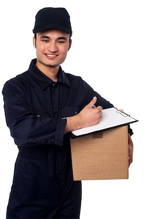 Young cheerful asian courier boy delivering you carton Stock Photo - Budget Royalty-Free & Subscription, Code: 400-08186476
