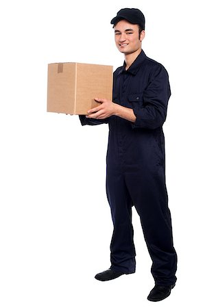 Young guy in uniform delivering parcel at your doorstep Stock Photo - Budget Royalty-Free & Subscription, Code: 400-08186478