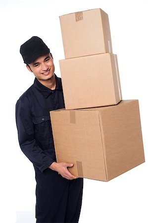 Young delivery boy holding stack of parcel boxes Stock Photo - Budget Royalty-Free & Subscription, Code: 400-08186480