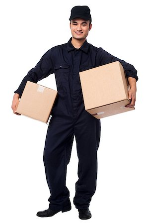 Smiling courier guy in blue uniform holding parcels in both hands Stock Photo - Budget Royalty-Free & Subscription, Code: 400-08186481