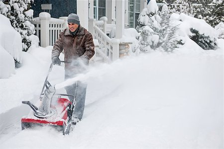 Man using snowblower to clear deep snow on driveway near residential house after heavy snowfall. Stock Photo - Budget Royalty-Free & Subscription, Code: 400-08199831
