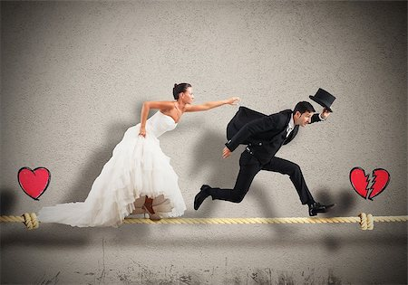 running away scared - Husband escapes from wife on a rope Stock Photo - Budget Royalty-Free & Subscription, Code: 400-08256211