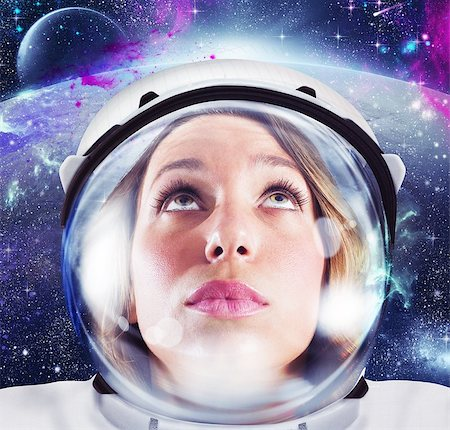 Woman astronaut looks space and infinity cosmos Stock Photo - Budget Royalty-Free & Subscription, Code: 400-08256543