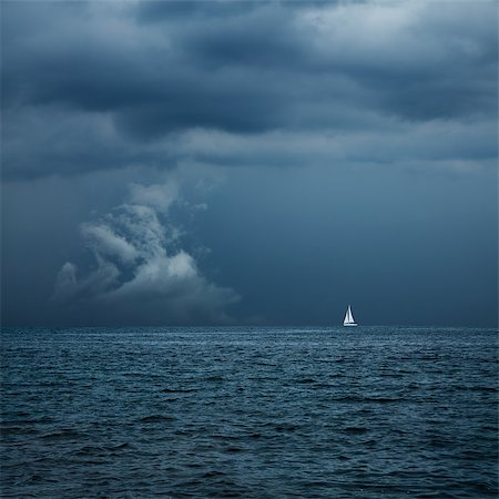 sailing boat storm - Boat Sailing in Center of Storm Formation. Dramatic Background. Danger in Sea Concept. Toned Photo with Copy Space. Stock Photo - Budget Royalty-Free & Subscription, Code: 400-08250921