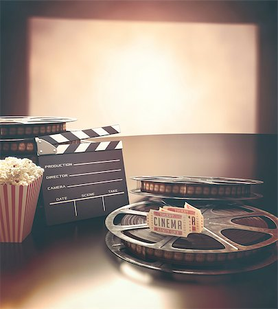 Objects related to the cinema on reflective surface. Stock Photo - Budget Royalty-Free & Subscription, Code: 400-08251814