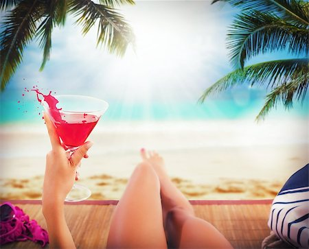 Girl relaxing on beach and drink cocktail Stock Photo - Budget Royalty-Free & Subscription, Code: 400-08252252
