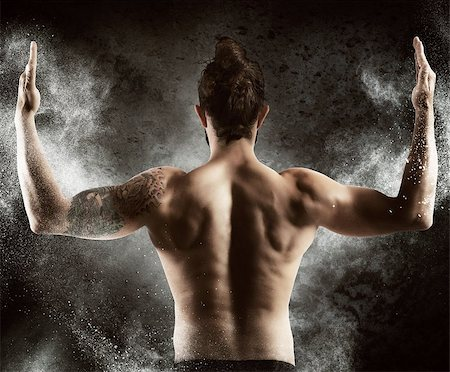 Muscle man shows off his muscular back Stock Photo - Budget Royalty-Free & Subscription, Code: 400-08252674