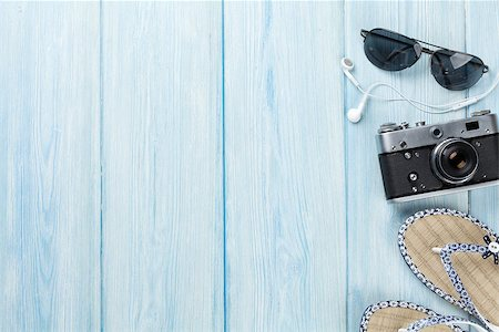 Travel and vacation items on wooden table. Top view with copy space Stock Photo - Budget Royalty-Free & Subscription, Code: 400-08289507