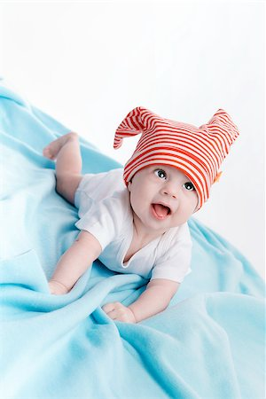 pzromashka (artist) - Baby in hat lying on a blue plaid Stock Photo - Budget Royalty-Free & Subscription, Code: 400-08283545