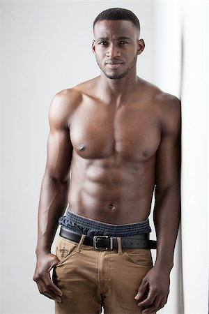 shirtless black boy - Men's Fitness, dark skinned model on white background Stock Photo - Budget Royalty-Free & Subscription, Code: 400-08296078