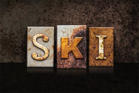 """The word """"SKI"""" written in rusty metal letterpress type on a dark textured grunge background. Stock Photo - Budget Royalty-Free & Subscription, Code: 400-08299123"""