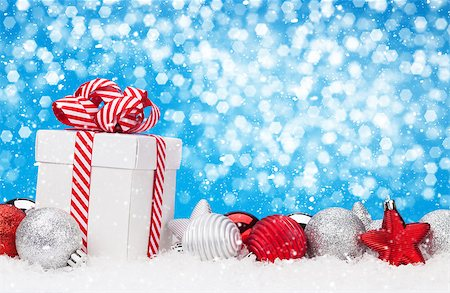 silver box - Christmas background with baubles, gift box and bokeh copy space Stock Photo - Budget Royalty-Free & Subscription, Code: 400-08299748