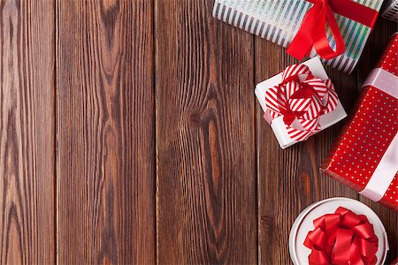 silver box - Christmas gift boxes on wooden table. Top view with copy space Stock Photo - Budget Royalty-Free & Subscription, Code: 400-08299759