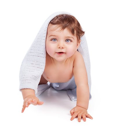 Cute little baby boy wrapped in blue towel after shower crawling in the studio over white background, happy healthy childhood Stock Photo - Budget Royalty-Free & Subscription, Code: 400-08292502
