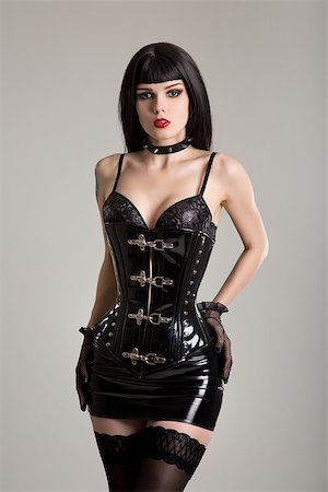 Young sexy woman in black fetish corset, mini skirt, and stockings Stock Photo - Budget Royalty-Free & Subscription, Code: 400-08316299