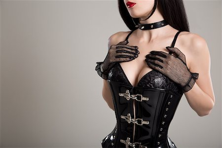 Close-up shot of sexy woman in black fetish corset and bra, studio shot Stock Photo - Budget Royalty-Free & Subscription, Code: 400-08316300