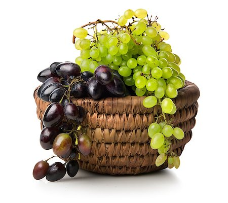 Green and purple grapes in a basket isolated on white Stock Photo - Budget Royalty-Free & Subscription, Code: 400-08334396