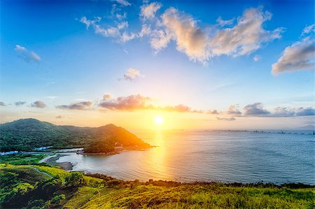 Village with beautiful sunset over hong kong coastline. View from the top of mountain Stock Photo - Budget Royalty-Free & Subscription, Code: 400-08334788