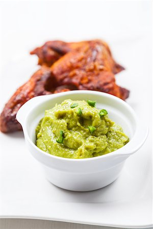 Grilled chicken wings with guacamole on white plate Stock Photo - Budget Royalty-Free & Subscription, Code: 400-08332070