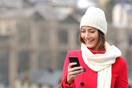 Girl texting in a mobile phone in winter Stock Photo - Budget Royalty-Free & Subscription, Code: 400-08345969