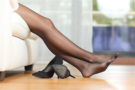 stocking feet - Tired woman legs resting on couch Stock Photo - Budget Royalty-Free & Subscription, Code: 400-08347277