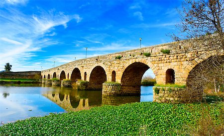 puentes - a view of the Puente Romano, an ancient Roman bridge over the Guadiana River, in Merida, Spain Stock Photo - Budget Royalty-Free & Subscription, Code: 400-08377688